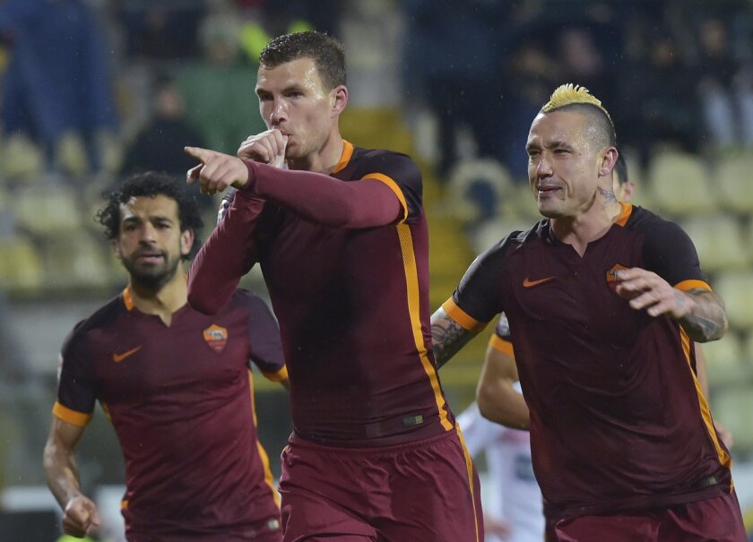 Roma's Edin Dzeko, left, celebrates with his teammate Radja Nainggolan after scoring against Carpi during their Italian Serie A soccer match at Braglia stadium in Modena, Italy, Friday, Feb. 12, 2016. (AP Photo/Marco Vasini)