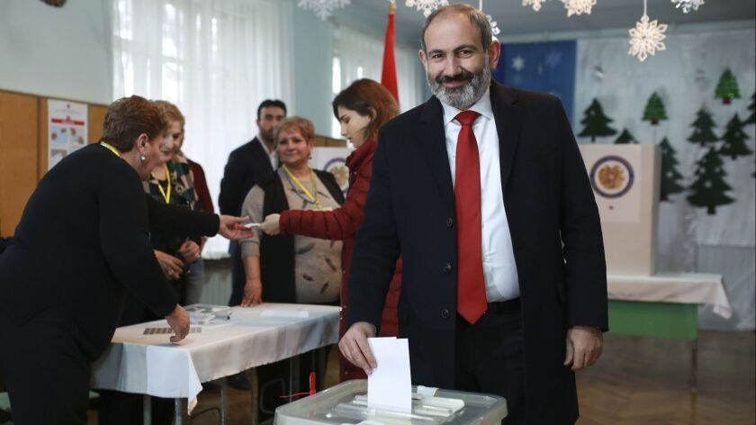 Armenian Prime Minister Nikol Pashinian casts his ballot during early parliamentary elections in Yerevan on Dec. 9.