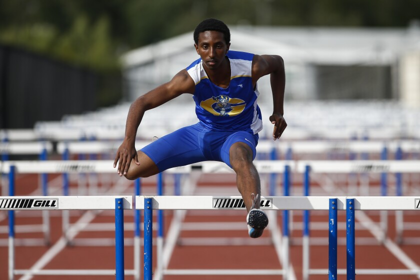 Leyikum Solomon, a hurdler from Grossmont High School, competes in the 110m hurdles on Thursday, April 11th, 2019 at a meet against El Cajon Valley.