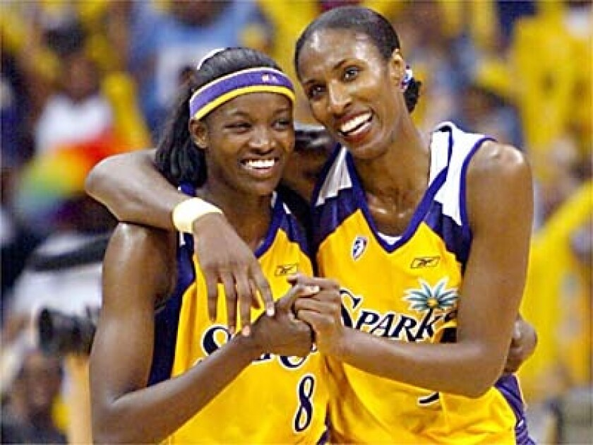 Sparks' Lisa Leslie, right, with teammate DeLisha Milton.