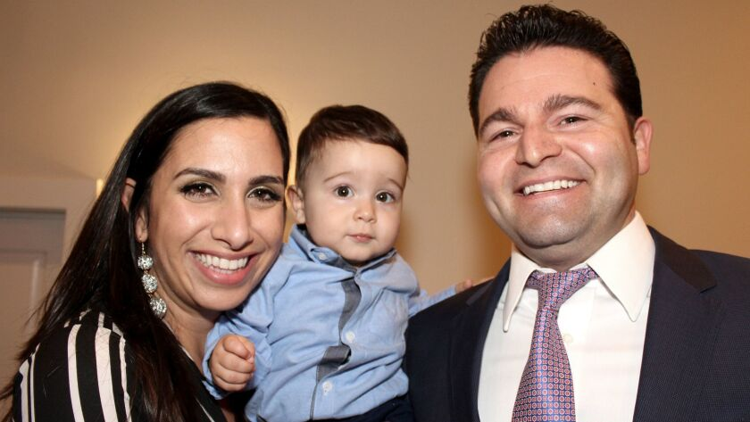 Awarded with the Glendale Educational Foundation's Paragon Diamond Award is Louie Sadd, founder and CEO of Datastream IT. His wife Tamar and 11-month-old Jack join him.