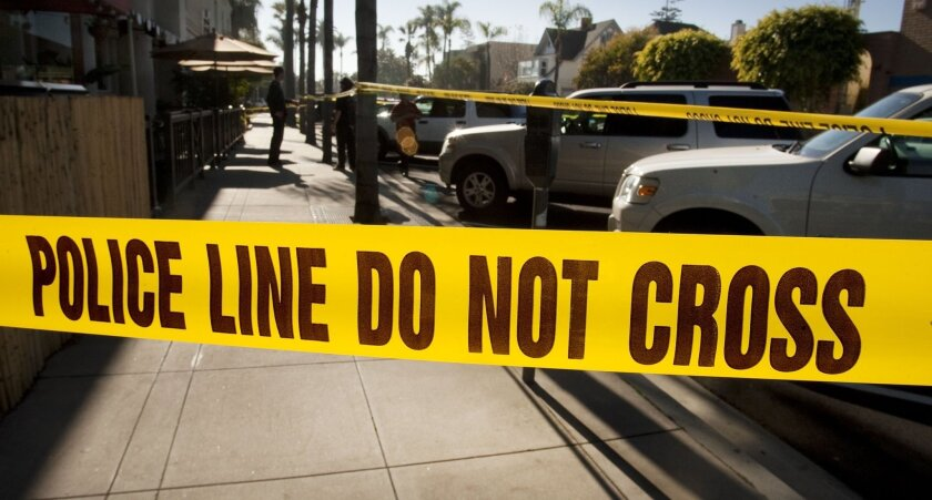 Police investigate the scene where three people were shot and killed by a suicidal Navy pilot in Coronado on New Year's Day 2012.