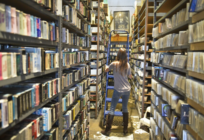 Maggie Mackay, executive director of Vidiots Foundation, among the rare DVDs and VHS tapes at the Vidiots video store on Pico Boulevard in Santa Monica before it closed in 2017.