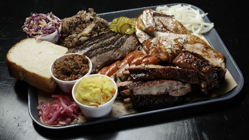 LOS ANGELES, CA -- OCTOBER 29, 2018: A BBQ platter at SLAB -- the first BBQ restaurant from postmast