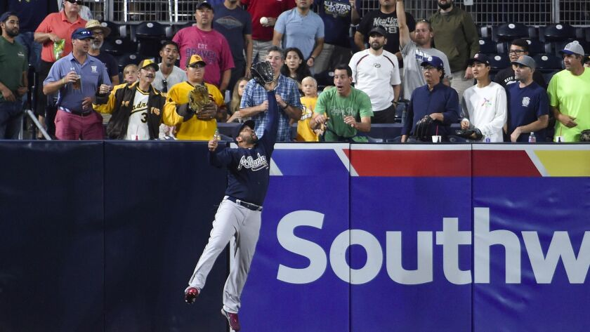 Matt Kemp of the Atlanta Braves makes the catch on a ball hit by Erick Aybar of the San Diego Padres during the fourth inning of a baseball game at Petco Park on June 27, 2017, in San Diego, California.