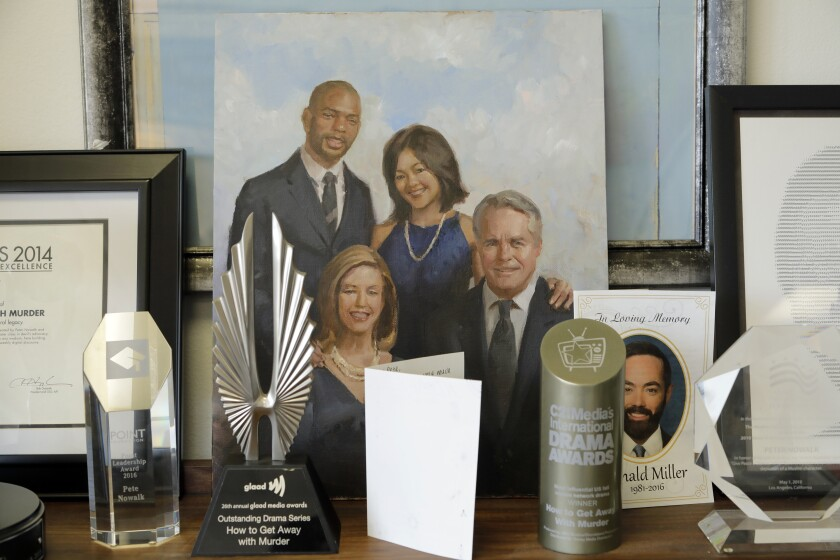"Pete Nowalk is the creator and showrunner of ABC's ""How to Get Away With Murder."" Awards and a portrait from Season 2 are displayed on his bookshelf."