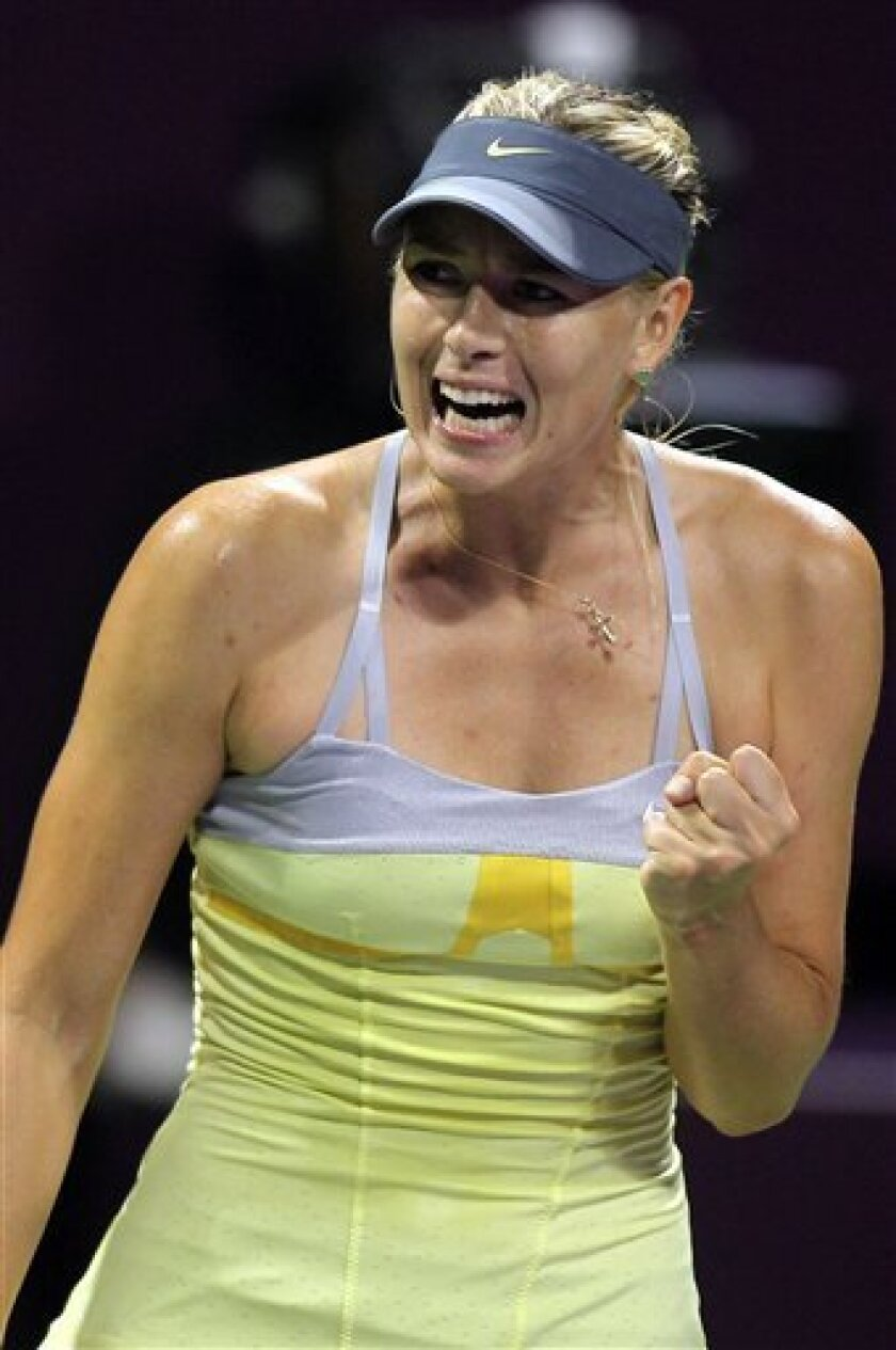 Maria Sharapova of Russia reacts after winning a point during her match against Caroline Garcia of France on the second day of the WTA Qatar Ladies Open in Doha, Qatar, Tuesday, Feb. 12, 2013. (AP Photo/Osama Faisal)