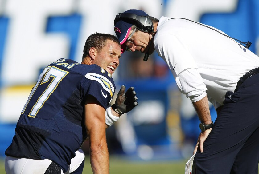 Philip Rivers and Frank Reich talk during a game against the New York Jets.