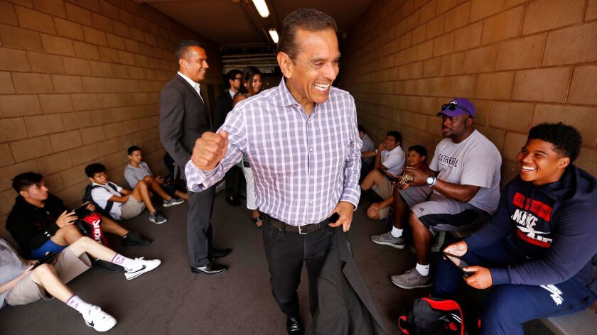 Villaraigosa gives a pep talk to students where he played football as a student at Cathedral High School, where he was kicked out for fighting and poor grades decades ago.