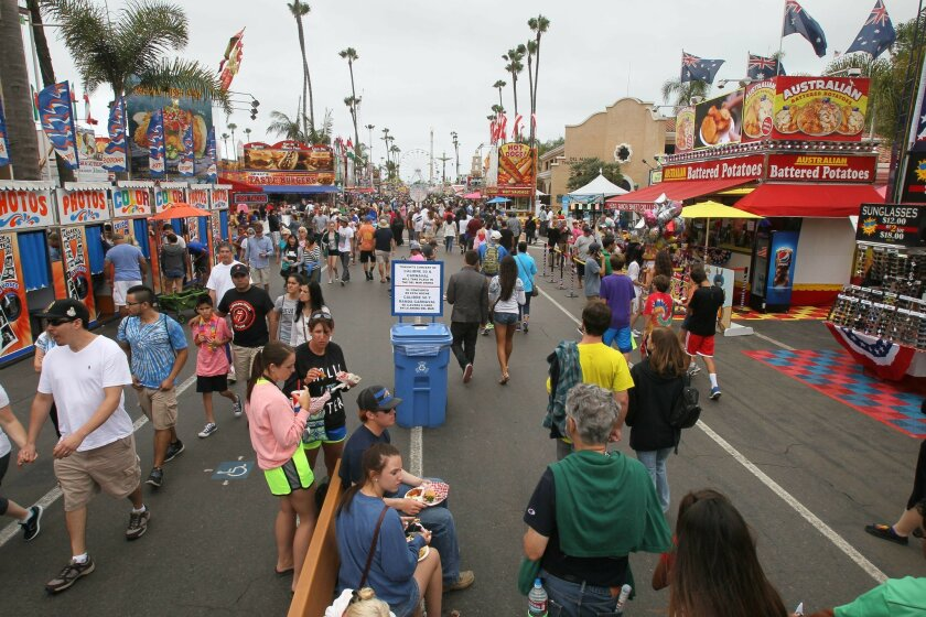 COVID-19 has people wondering when crowds line the midway on the last day of the 2015 San Diego County Fair.