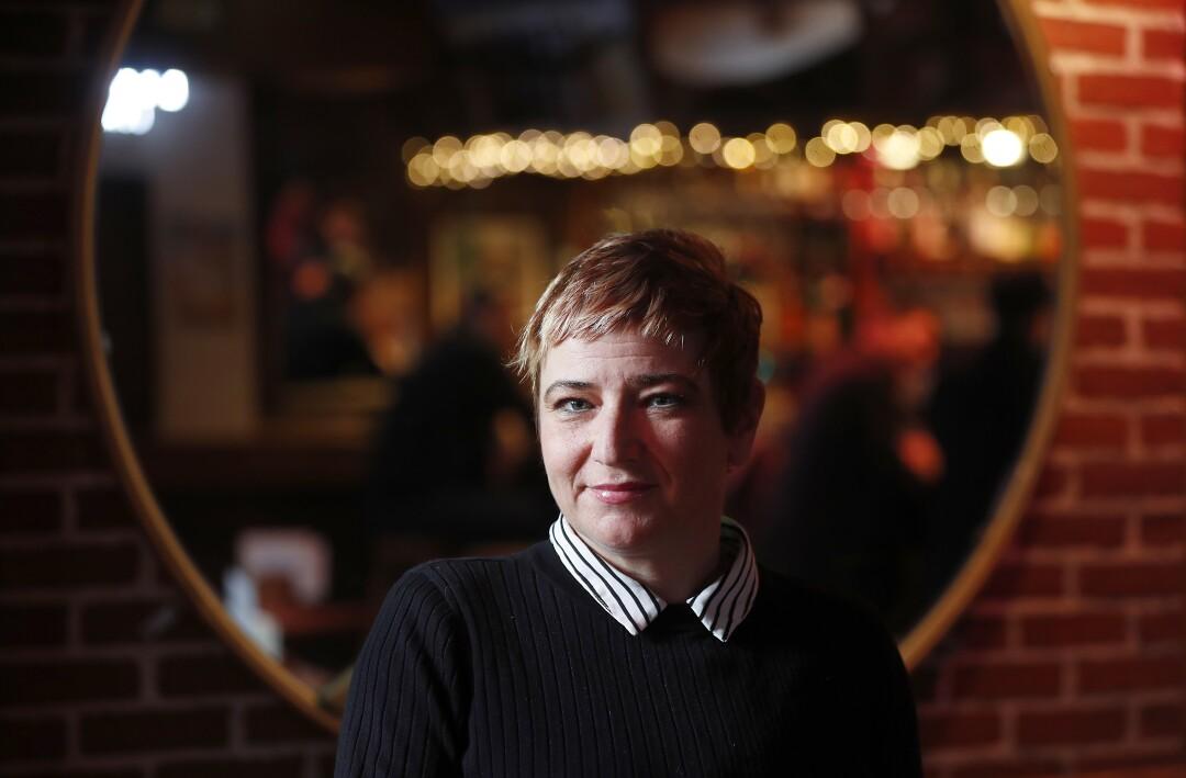 Kari Kuelzer is the owner of Grendel's Den restaurant near the campus of Harvard University.