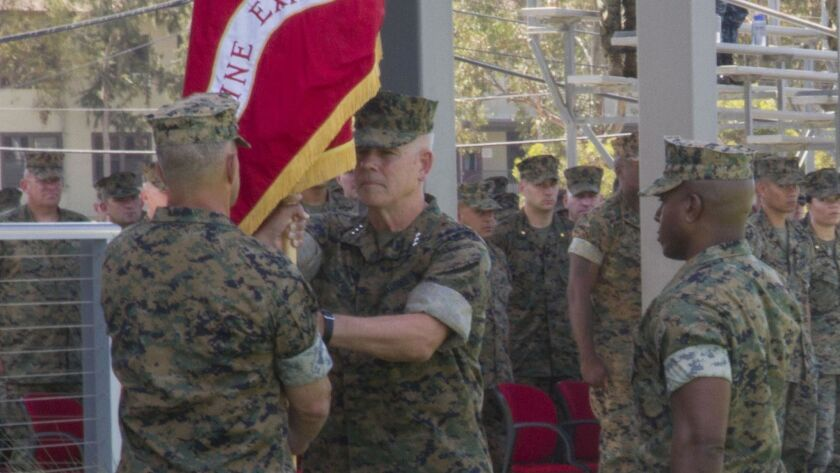 Lt. Gen. Joseph Osterman accepts the command colors from Lt. Gen Lewis Craparotta, signifying the change of command of I Marine Expeditionary Force at Camp Pendleton, CA, on July 30, 2018.