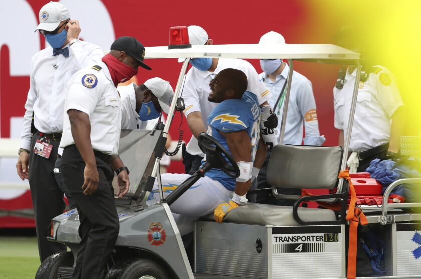 Chargers running back Austin Ekeler is carted off the field.