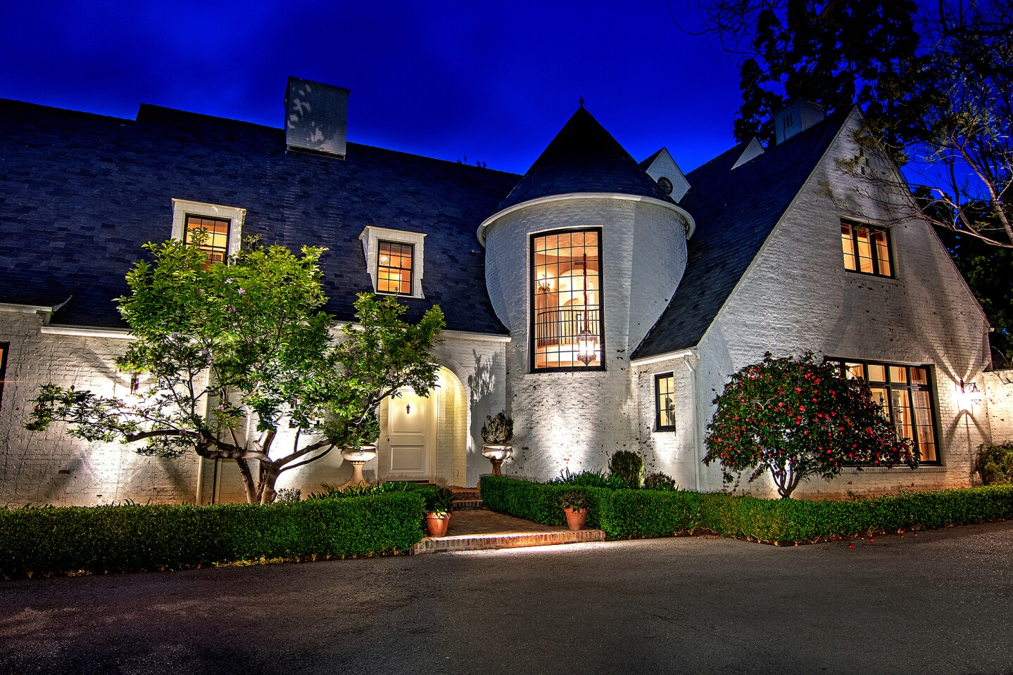 Lindsey Buckingham of Fleetwood Mac fame sold his French Normandy-inspired home in Brentwood for $28 million. The roughly 10,000-square-foot house was custom built for the Fleetwood Mac rocker and his wife, interior designer Kirsten Buckingham. Set on more than an acre, the double-lot property includes a tennis court, a gym, a guest house and a screening room.