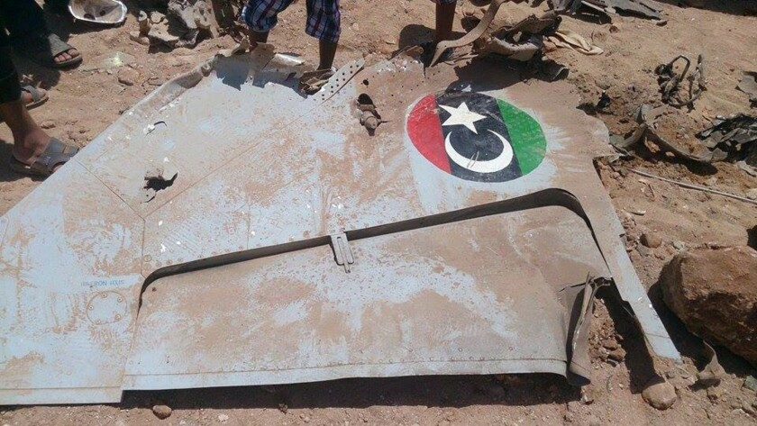 Wreckage from a Libyan paramilitary fighter lies on the ground after it crashed in the eastern city of Benghazi during fighting with Islamist groups on July 29.