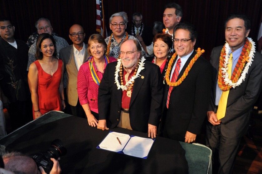 Gov. Neil Abercrombie, center, with legislators and supporters in Honolulu after he signed a bill legalizing gay marriage in Hawaii.