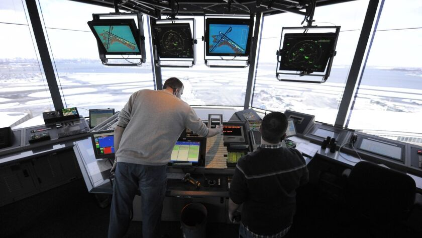 Air-traffic controllers work at LaGuardia Airport in New York in 2011.