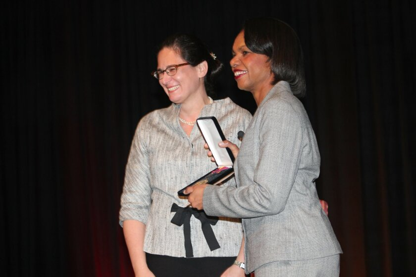 Former U.S. Secretary of State Condoleezza Rice accepts the Bishop's Medal from Head of School Aimeclaire Roche during a presentation at the Bishop's school Jan. 19, 2012. Pat Sherman photos