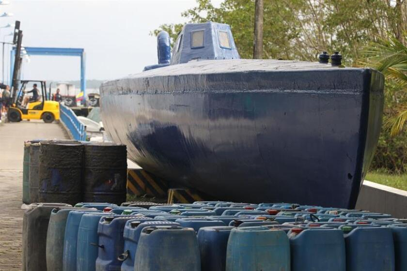 This photo of a small submarine used by drug traffickers was taken on Nov. 7, 2018, after being seized by the Colombian navy on the nation's Pacifice coastline, where a perfect storm of drug trafficking, illegal mining and gang conflict is blowing up that threatens to extend violence to the rest of the territory. EFE-EPA/Ernesto Guzman Jr.