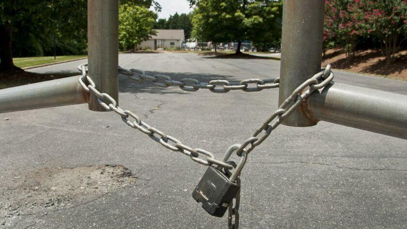 This photo shows the locked gate of the Glenridge Community Pool in Winston-Salem, N.C., Friday, Jul