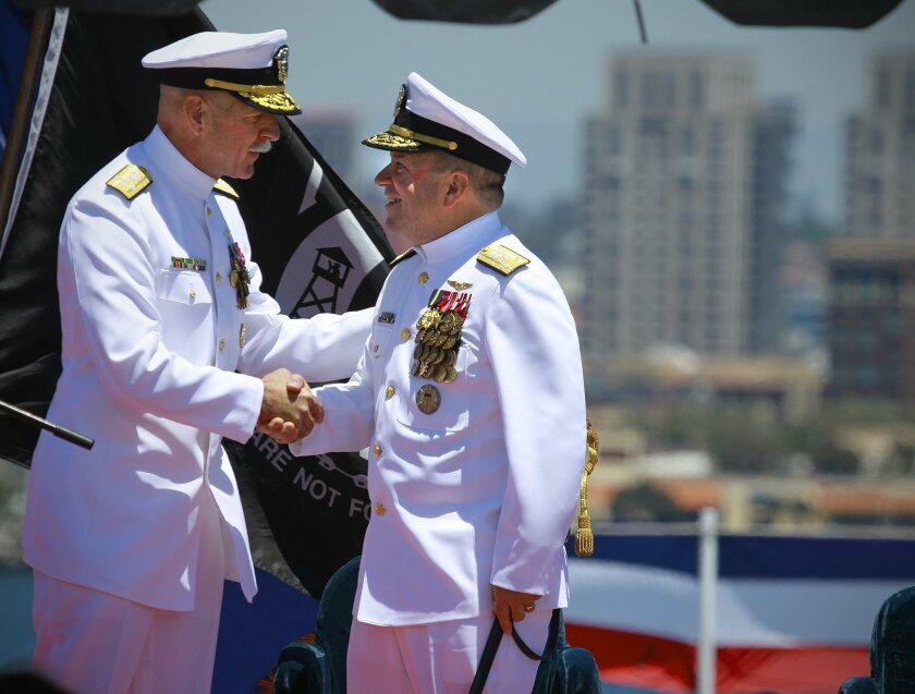 Navy Admiral Scott Swift, left, Commander of the U.S. Pacific Fleet, congratulates Vice Admiral Kenny Floyd,   outgoing commander of the Third Fleet, during a change of command ceremony on the flight deck of the USS Ronald Reagan at North Island Naval Air Station. Floyd is retiring after 35-years