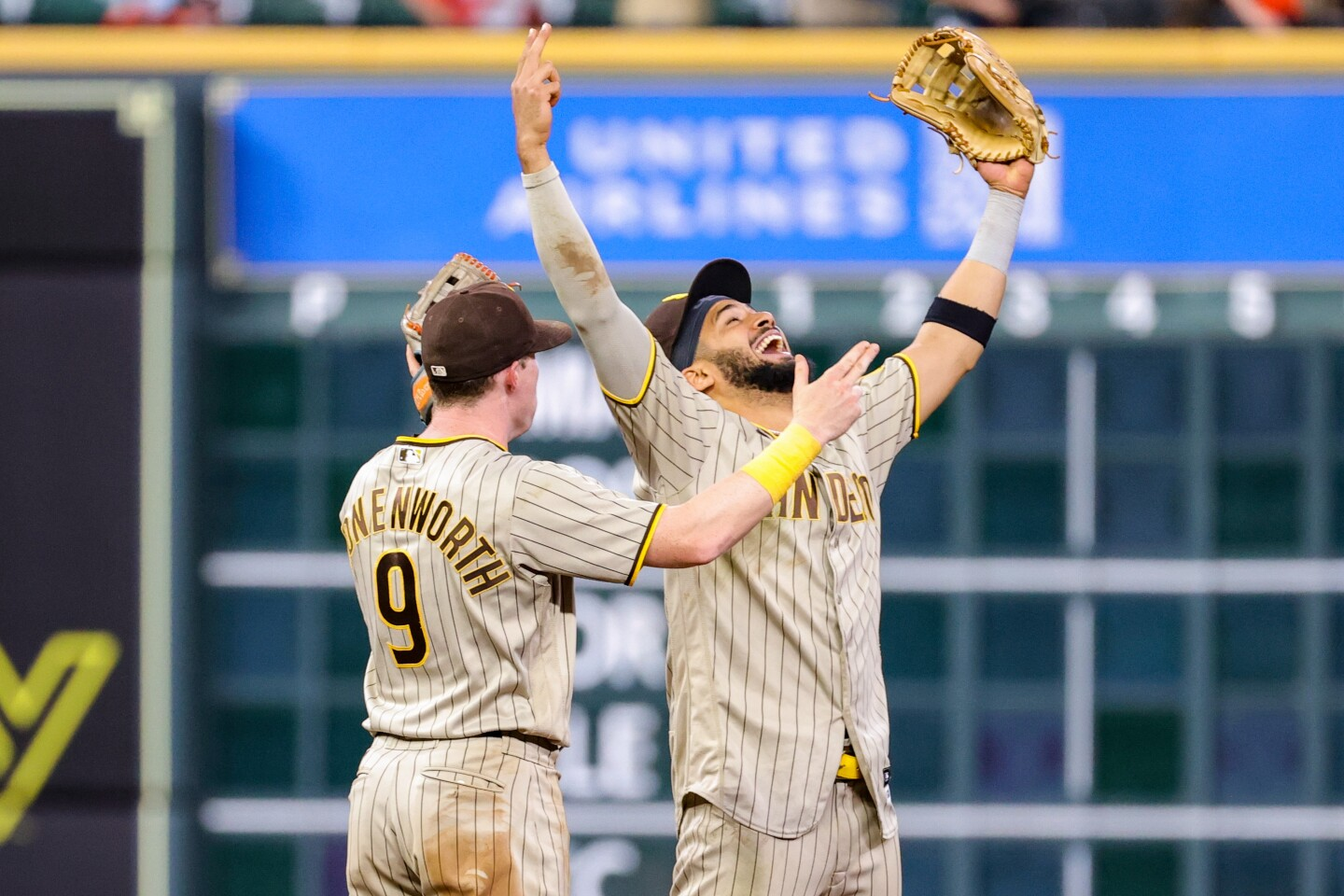 HOUSTON, TEXAS - MAY 28: Fernando Tatis Jr. #23 and Jake Cronenworth #9 of the San Diego Padres celebrate defeating the Houston Astros 10-3 at Minute Maid Park on May 28, 2021 in Houston, Texas. (Photo by Carmen Mandato/Getty Images)