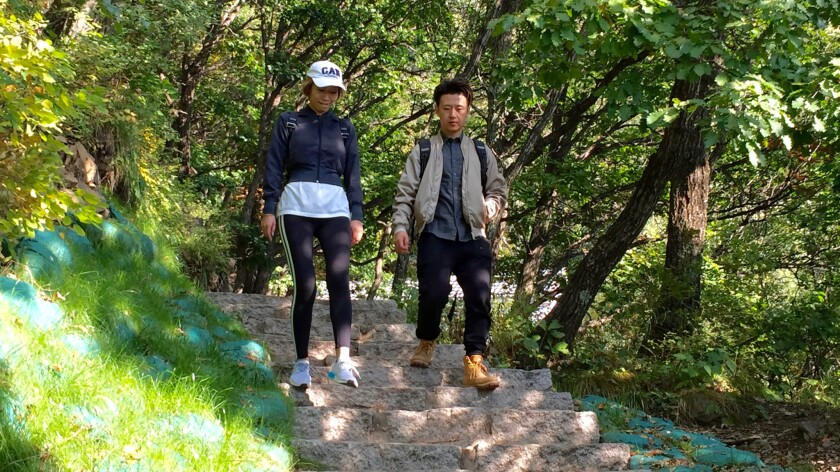 Wang Zhan and Fan Lei hike in Baihuashan National Nature Preserve in China.