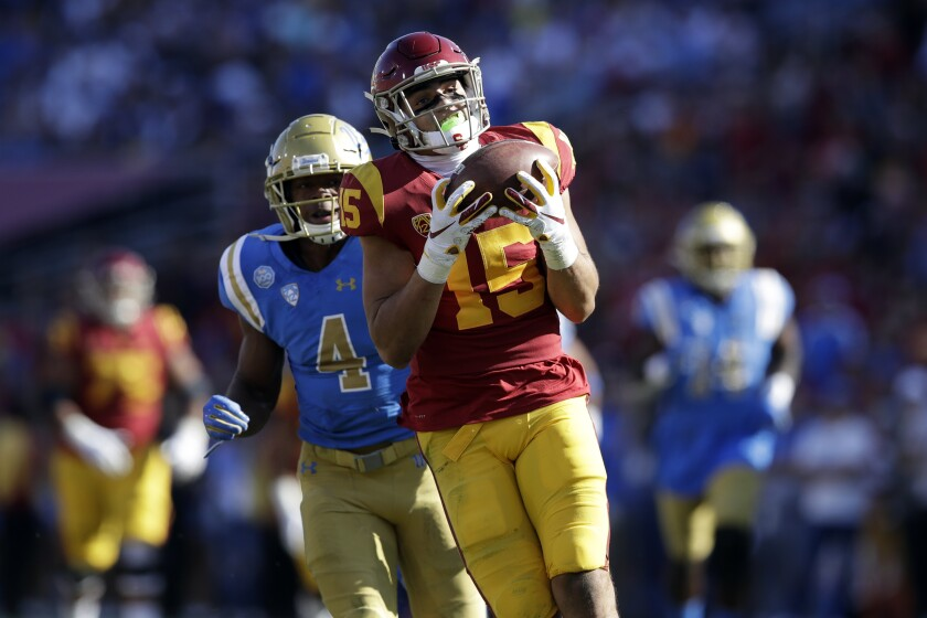 USC receiver Drake London pulls in a catch Nov. 23 at the Coliseum.