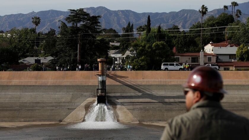 Water flows into the Silver Lake Reservoir Complex Tuesday, April 25, 2017, in Los Angeles. Two year
