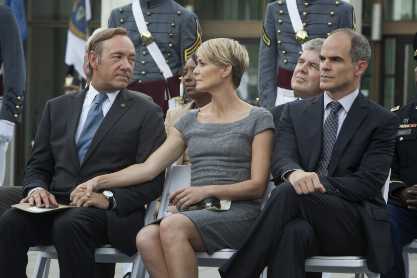"Kevin Spacey, left, Robin Wright and Michael Kelly in a scene from Netflix's ""House of Cards."""