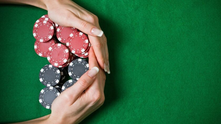 A closeup of female hands taking the jackpot from the table