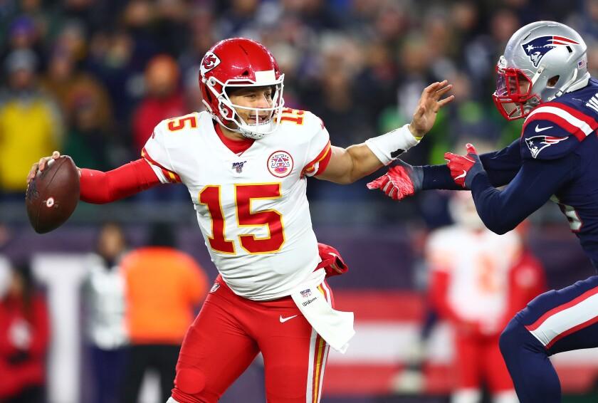 Kansas City Chiefs quarterback Patrick Mahomes is pressured by New England Patriots linebacker Kyle Van Noy