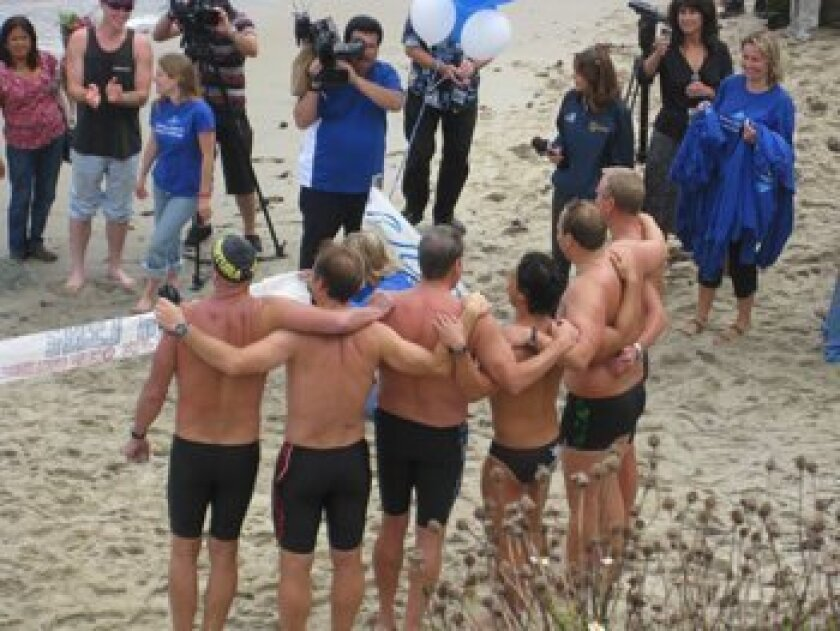 The Ventura Deep Six Team greets the crowd after arriving at La Jolla Cove on Monday. Photos by Marta R. Gaughen