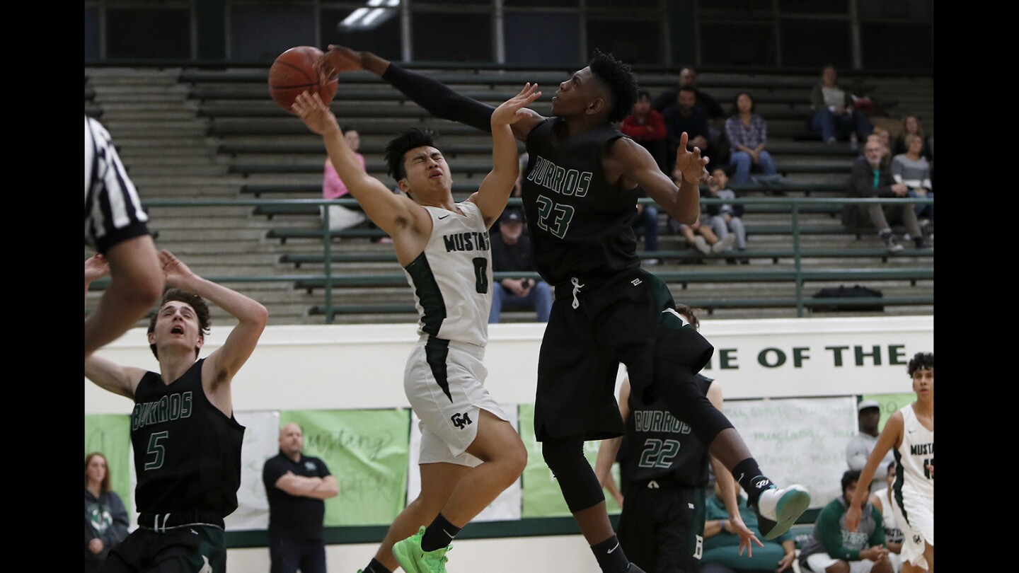 Photo Gallery: Costa Mesa vs. Ridgecrest Burroughs in boys' basketball