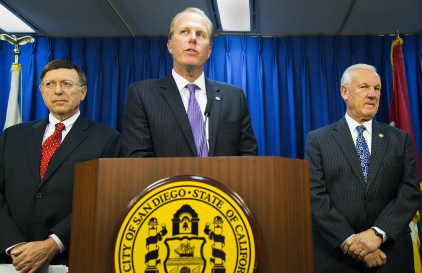 San Diego Mayor Kevin Faulconer, center, San Diego City Attorney Jan Goldsmith, left, and San Diego County Supervisor Ron Roberts, right, answer questions during a city hall press conference to address the latest developments of the San Diego Chargers possible move to Los Angeles, or stay in San Di