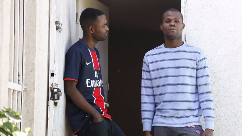 Godneil Chatelain, left, and Nickson Pierre, right, are cousins from Gonaives, Haiti now living and working in Tijuana.