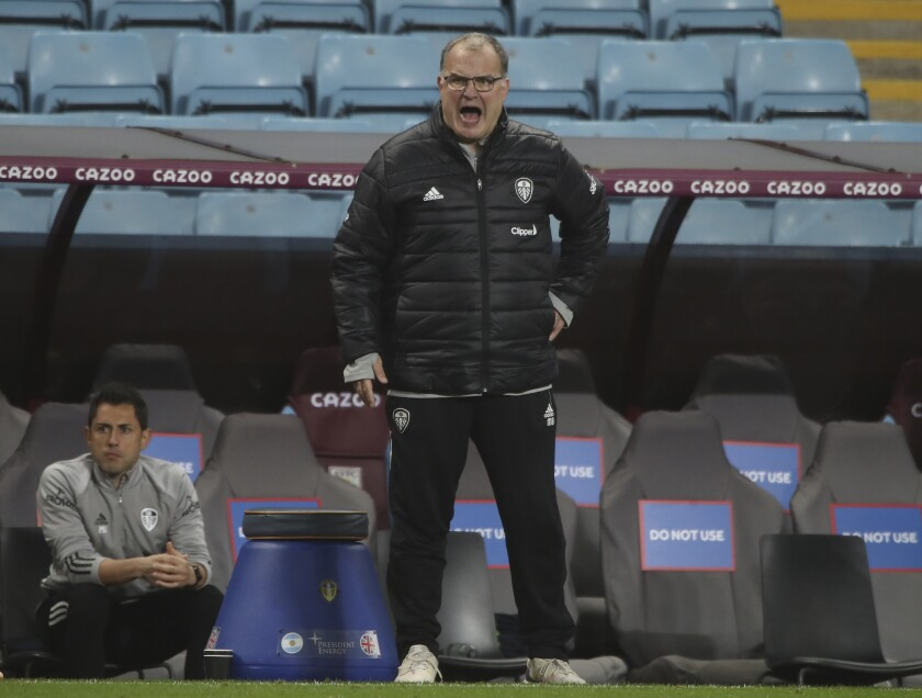 Leeds United's head coach Marcelo Bielsa yells to his players during the English Premier League soccer match between Aston Villa and Leeds United at Villa Park in Birmingham, England, Friday, Oct. 23, 2020. Leeds United won the match 3-0.(Nick Potts/Pool via AP)