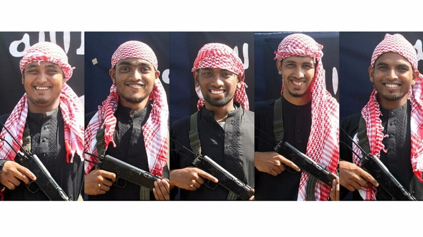 This combination of pictures shows five unidentified men, allegedly the gunmen who carried out an attack in the capital Dhaka on Friday, posing in front of an Islamic State flag.