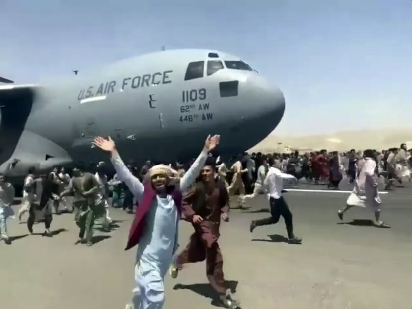 Hundreds of people run alongside a U.S. Air Force plane in Kabul, Afghanistan.