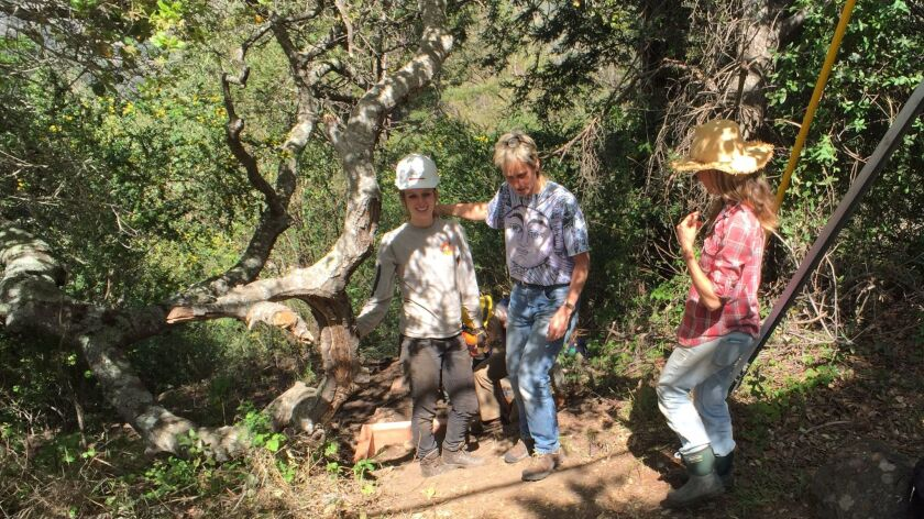 Big Sur residents are helping build a foot trail around a downed bridge. From left, wildlife biologist Amy List with Carissa Chappellet and her cousin, Heather Chappellet.