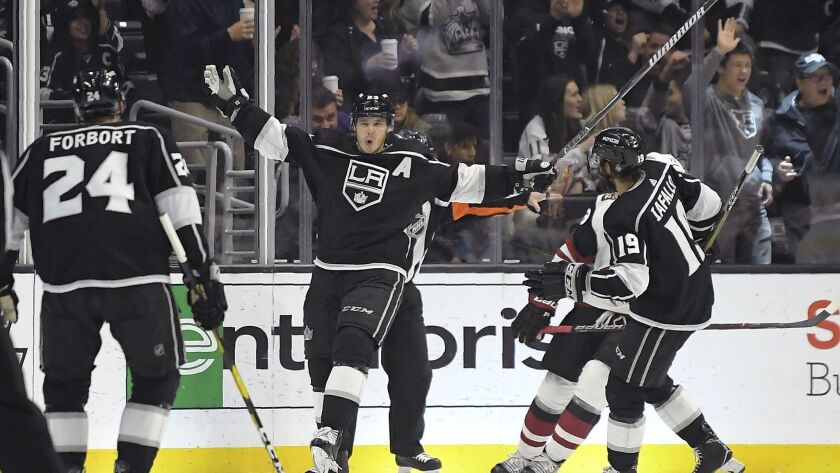 Kings right wing Dustin Brown, center, celebrates his goal with defenseman Derek Forbort, left, and left wing Alex Iafallo during the third period.