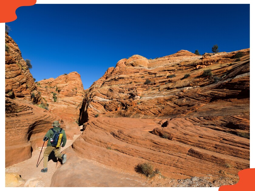 A hiker on a trail at Wire Pass Canyon near Kanab, Utah.
