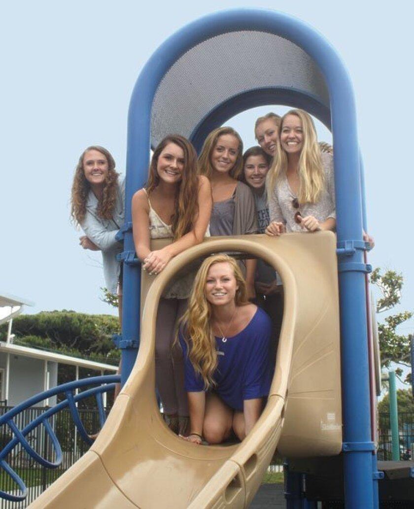 Maddie Pickett (in slide), plays with Erin Riley, Kristen Crabb, Sarah Schug, Jessica Savage, Caroline Feeney and Paige Liss on their  old playground.