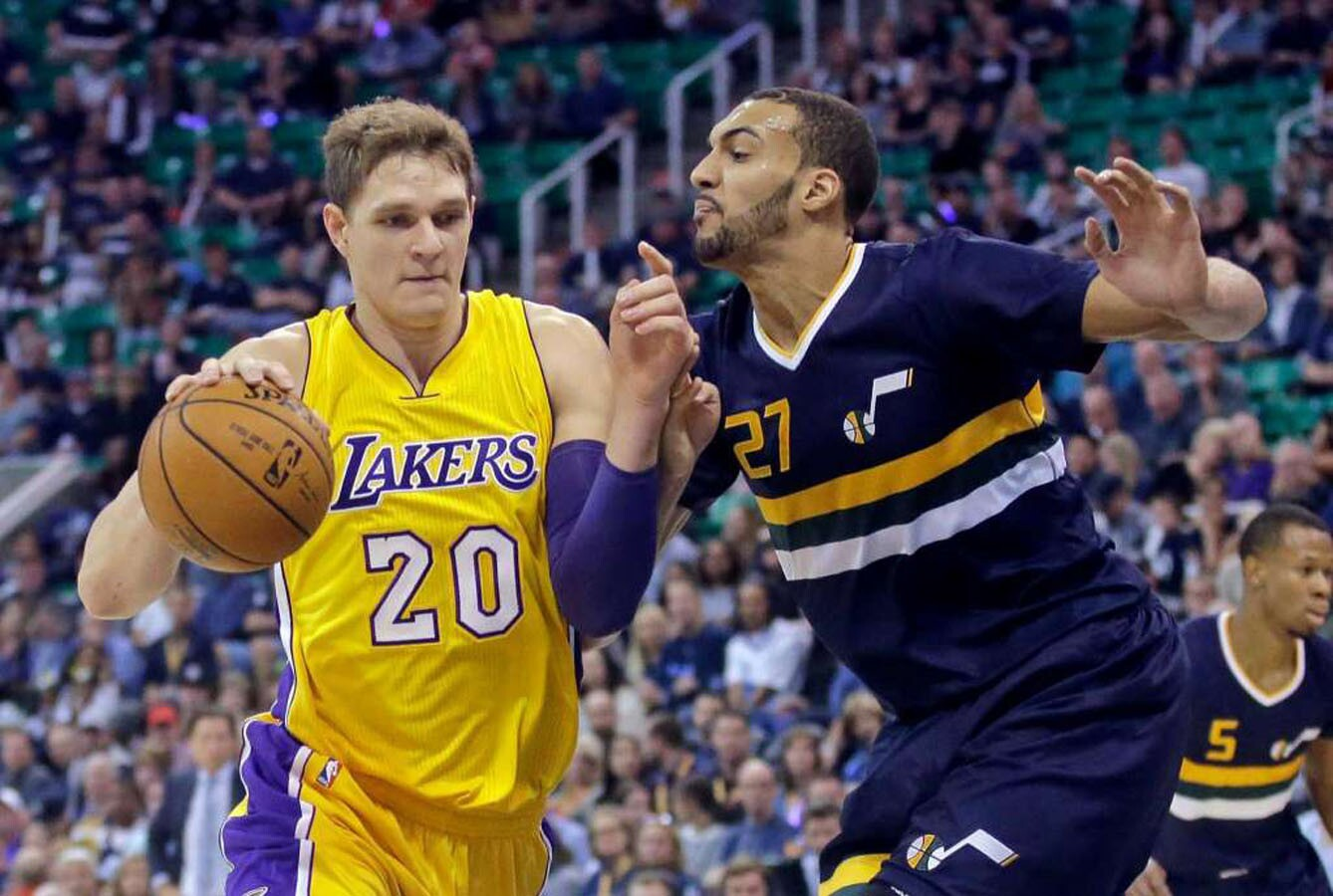 Utah Jazz center Rudy Gobert (27) defends Los Angeles Lakers center Timofey Mozgov (20) during the first quarter of an NBA basketball game Friday, Oct. 28, 2016, in Salt Lake City.