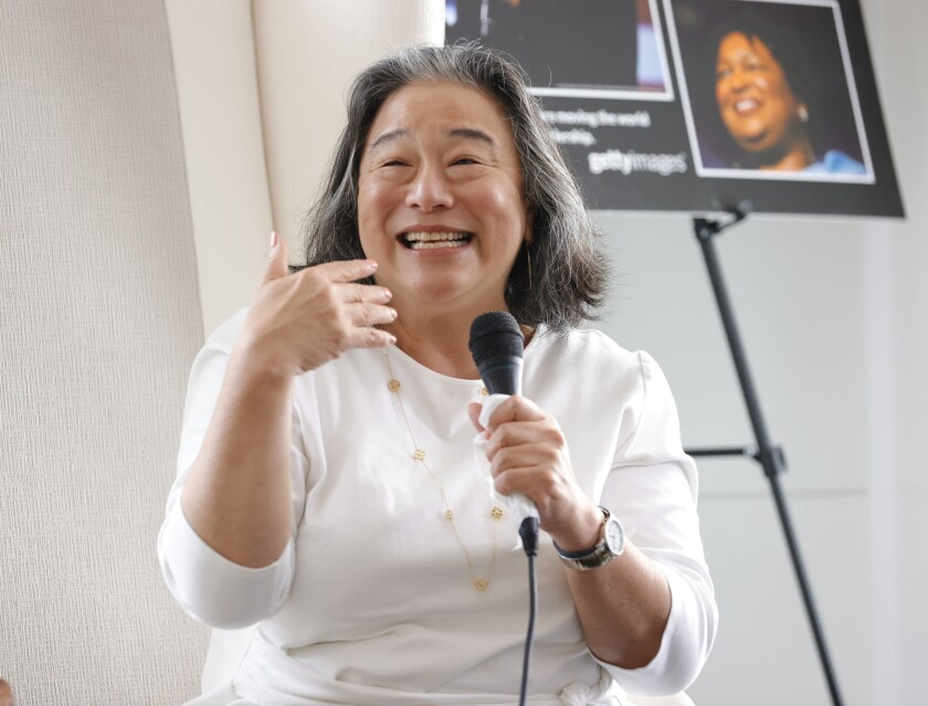 Tina Tchen, president and chief executive of Time's Up, speaks into a handheld mic