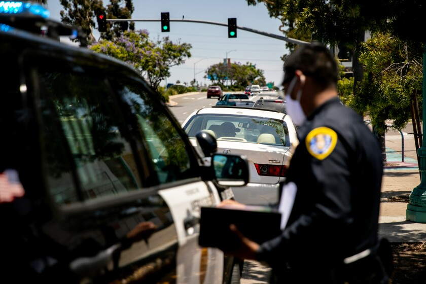 San Diego Police Department officers make a traffic stop along El Cajon Boulevard on June 23, 2020 in San Diego, California.