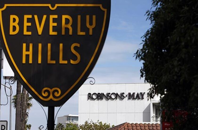 A Beverly Hills sign is seen in front of a Robinsons-May department store