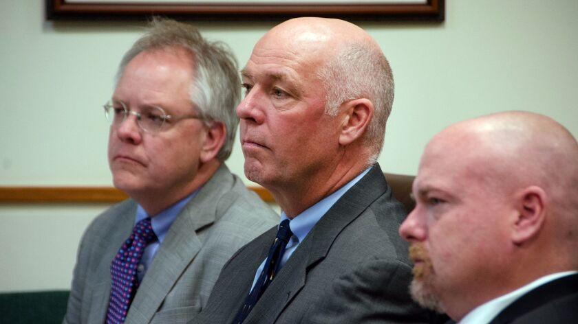 Congressman-elect Greg Gianforte, center, sits alongside William Mercer, left, and Todd Whipple Mond