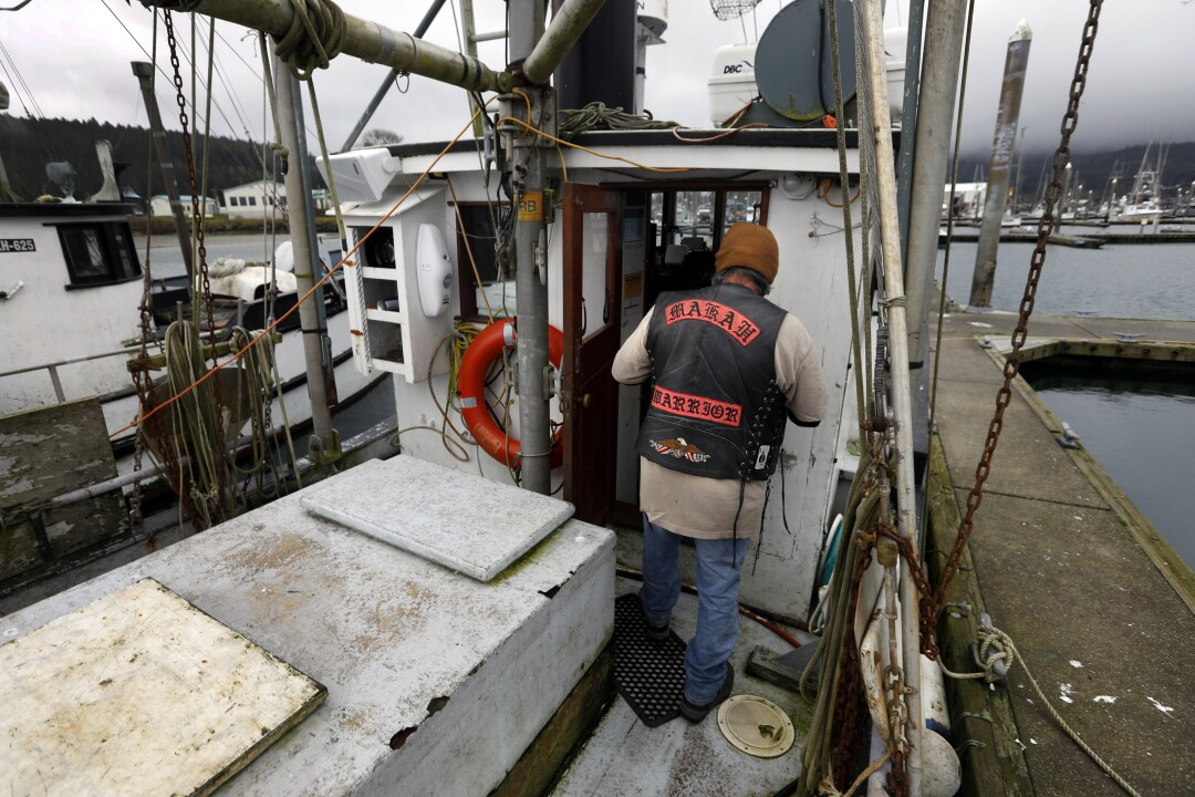 Gordon Steeves Jr., a Makah fisherman, works on a boat in Neah Bay