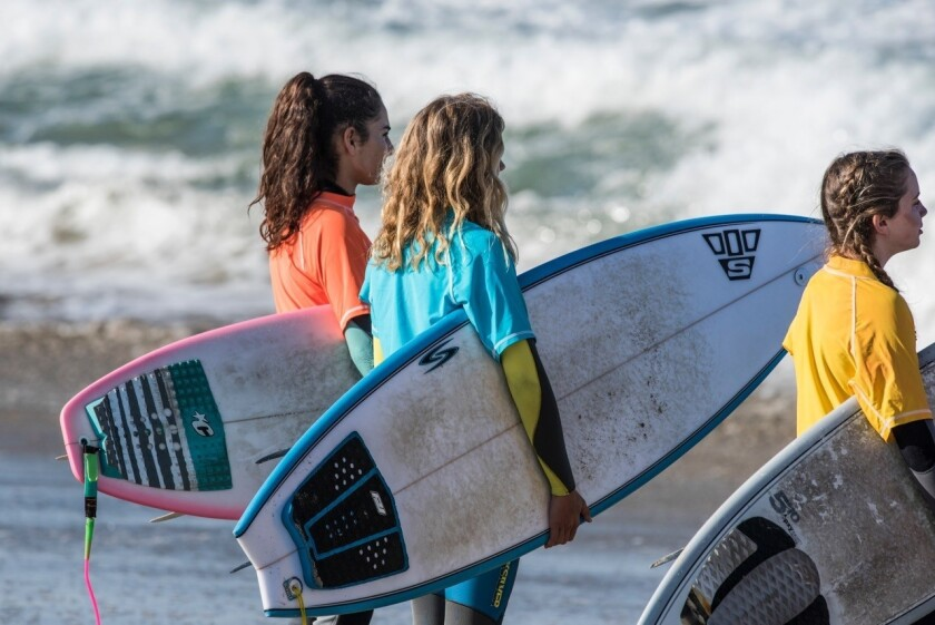 From left, Nikka Tehrani, Sarah Bentley and Nell Kerndt compete in the junior high division of Saturday's surf tournament.